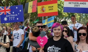 People attend a rally in support of same-sex marriages in Sydney on 3 December 2011.