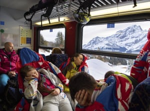 Lausanne, Switzerland Athletes from Romania grab every opportunity for extra rest on the early train to the Ski Mountaineering competition at Villars Winter Park during The Winter Youth Olympic Games