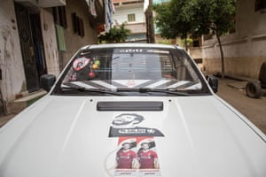 A pickup truck in Nagrig is adorned with images of Salah