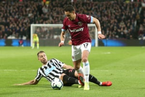 Florian Lejeune of Newcastle slides in and catches the ankle of  Javier Hernandez of West Ham to give away a penalty.