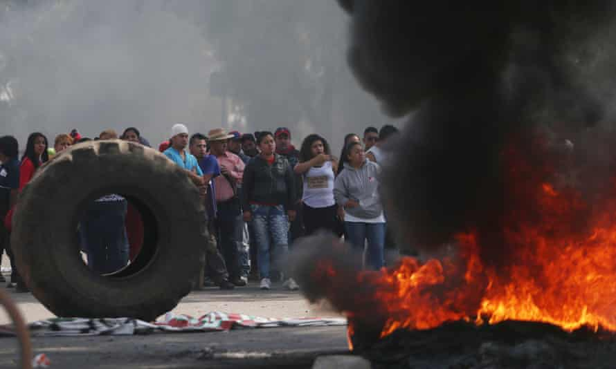 Protesters block the entrance to a Pemex gas station as they burn tires during a protest against the rising prices of gasoline, in San Miguel Totolcingo, Mexico Tuesday.