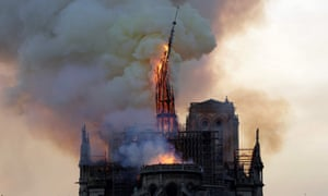The steeple and spire of the landmark Notre Dame cathedral collapses in flames in central Paris on April 15, 2019.
