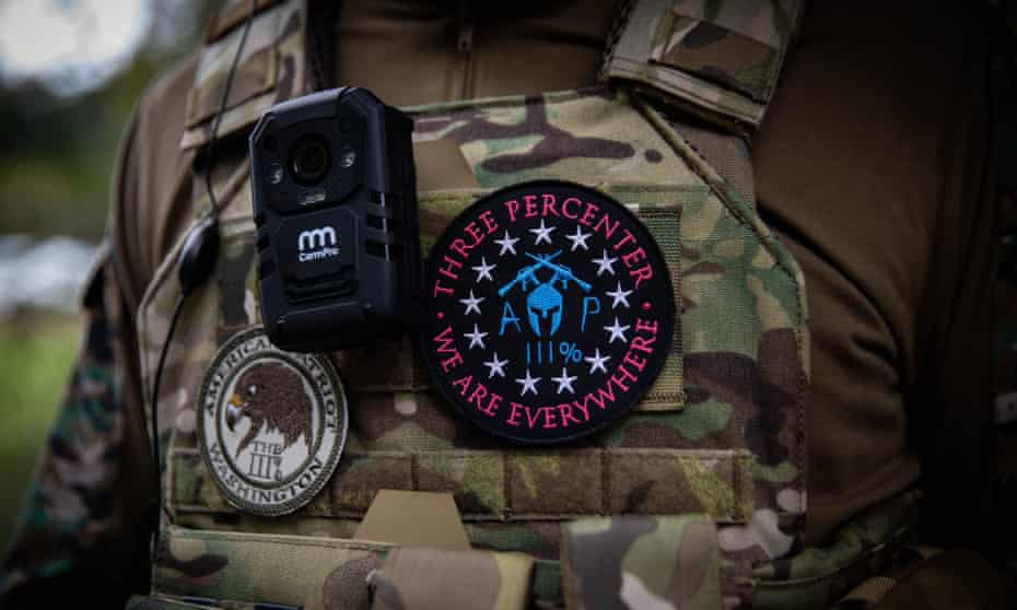 A man wears a Three Percenters patch during a Proud Boys rally in Portland, Oregon, on 26 September 2020.