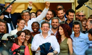 Jean-Luc Mélenchon, surrounded by his new MPs, at the National Assembly