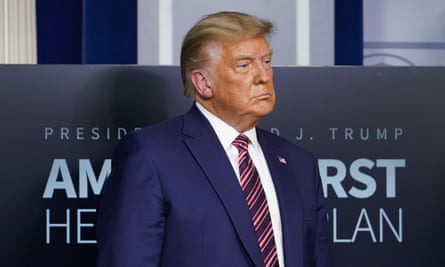 Donald Trump listens during a news conference at the White House on 20 November.