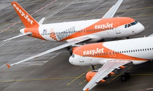EasyJet planes are parked on the apron during the opening of Berlin Brandenburg Airport on October 31.