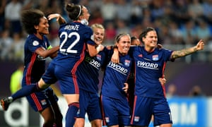Lyon celebrate the final goal by Camille Abily in their record-breaking win over Wolfsburg.