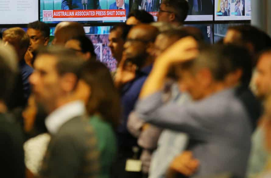 AAP staff react during Tuesday's announcement that the news wire service will shut down