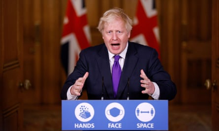 The prime minister Boris Johnson during a media briefing on coronavirus in Downing Street as politicians continued to link the speed of licensing the vaccine to UK's exit from the European Union.
