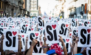 Activists and supporters of gay rights raise a sign to say 'yes to gay marriage' at a parade in Milan last month.