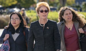 Marie Yovanovitch, center, arrives on Capitol Hill to testify before congressional lawmakers on 11 October.