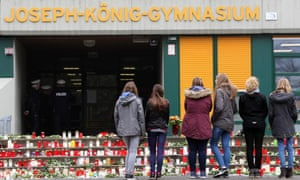 Students mourn in front of their school in Haltern, western Germany.