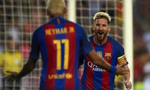 Lionel Messi of FC Barcelona celebrates scoring his team's second goal with his teammate Neymar.