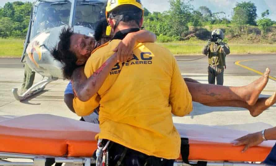 A rescue worker helping Murillo after her rescue.