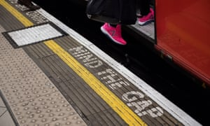 A woman boards an underground train at Bank station as the deadline nears for companies to report their gender pay gap on April 4, 2018 in London, England.