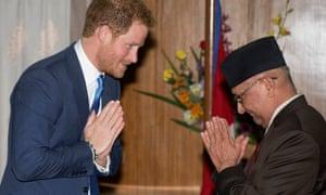Prince Harry greets Prime Minister Oli.