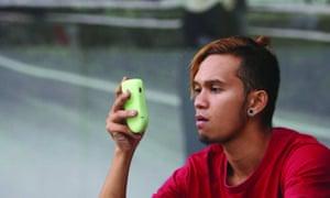 Thailand man on mobile phone