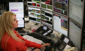 Female  trader in central London at her screens