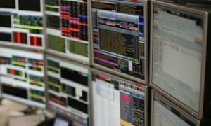 Trading screens at ETX Capital.