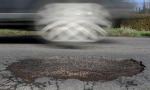 a pothole on a road
