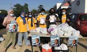 Volunteers for Long Island south Asian congressional candidate Shaniyat Chowdhury hand out gyros outside the legally mandated distance from a polling site in June.