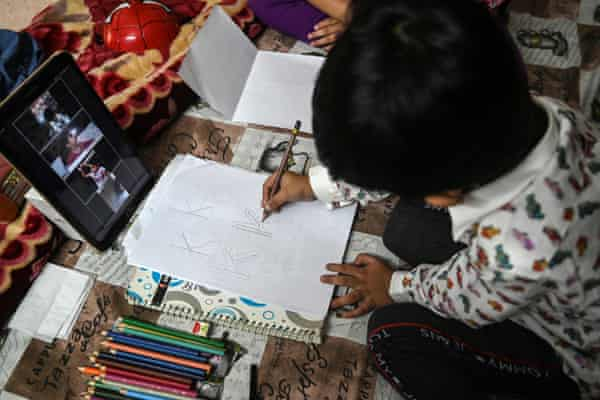 Five-year-old Mohammad Ibrahim follows an online class from home during Pakistan's nationwide lockdown.