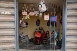 As well as schooling, Ajayi runs her own business making and selling purses and bags