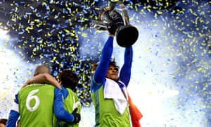 Seattle Sounders defender Roman Torres, who scored the winning penalty, celebrates with the MLS Cup.