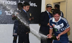Milligan celebrates in customary fashion after collecting the man-of-the-match award and lifting the trophy.