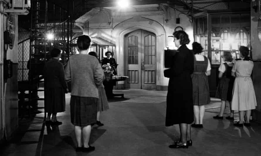 Women waiting to be called in for their evening classes at Holloway Prison, London, undated photograph.