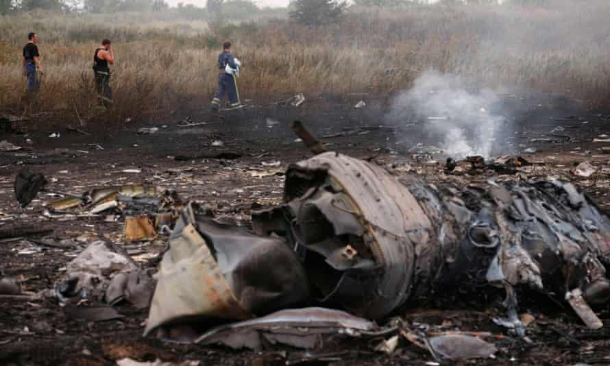 Emergencies ministry members walk at the site of a Malaysia Airlines Boeing 777 plane crash in Donetsk on 17 July 17 2014.