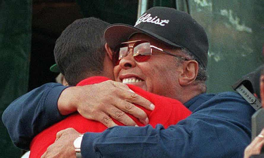 Tiger Woods is hugged by his father, Earl, after winning the 1997 Masters with a course-record 270, 18 under par and a 12-shot winning margin.