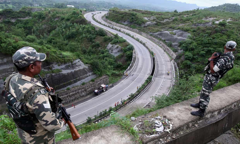 Members of India's security forces patrol the Jammu-Srinagar highway in Nagrota near Jammu on Wednesday.