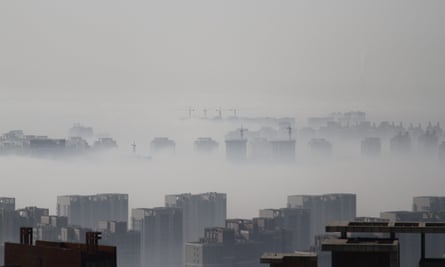 China's urban sprawl shrouded in fog. Shenyang