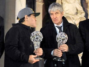 Rossi and Diego Maradona pose for a photo at the Italian football hall of fame awards ceremony in Florence in 2017.