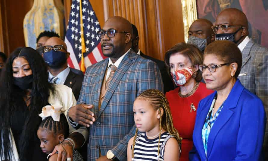 Philonise Floyd, brother of George Floyd, speaks as he and members of the Floyd family meet with Nancy Pelosi, second right, and Karen Bass, right, in May.