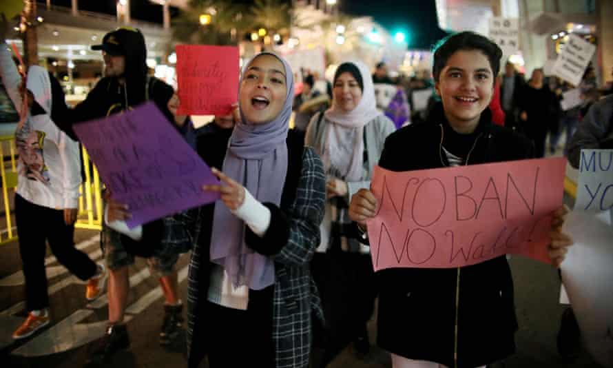 Hundreds march in protest against the travel ban on Tuesday.