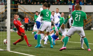 Gareth McAuley again holds off the defenders to score his second goal for Northern Ireland.
