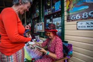 A festival goer and a fortune teller share a laugh