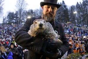 Groundhog Club co-handler Al Dereume holds Punxsutawney Phil, the weather-prognosticating groundhog. Phil's handlers said the groundhog had forecast an early spring