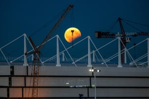 Kaliningrad, Russia A partial eclipse of the sturgeon moon over Kaliningrad stadium being built for the 2018 Fifa World Cup