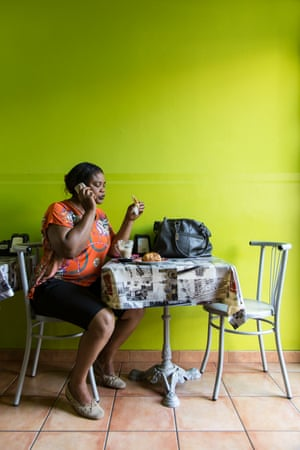 Princess Inyang Okokon, a former victim of sex trafficking, in a coffee shop in Asti, Italy.