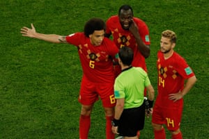 Belgium's Axel Witsel, left, Romelu Lukaku and Dries Mertens attempt to change the mind of Uruguayan referee Andres Cunha.