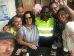 Kathy Mikkelsen and friends, with Ibrahim, the Safeway trolley attendant who hosted them in Bega on New Year's Eve, after they evacuated Mallacoota and then Tathra
