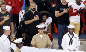 San Francisco 49ers quarterback Colin Kaepernick kneels during the national anthem before the team's NFL preseason football game against the San Diego Chargers on Thursday.