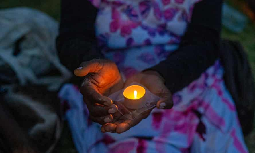 A candle light vigil in front of Alice Springs law courts for Kumanjayi Walker