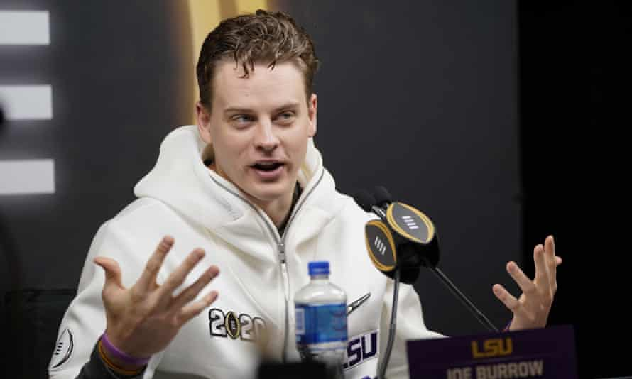 Joe Burrow shows off his tiny hands at an LSU press conference.