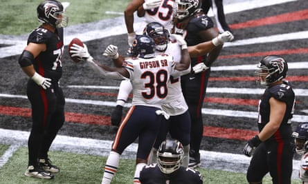 The Chicago Bears celebrate after a game clinching interception