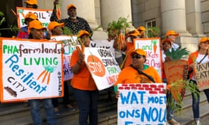 Farmers and workers protest outside the Western Cape High Court against plans to rezone part of the Philippi Horticultural Area.
