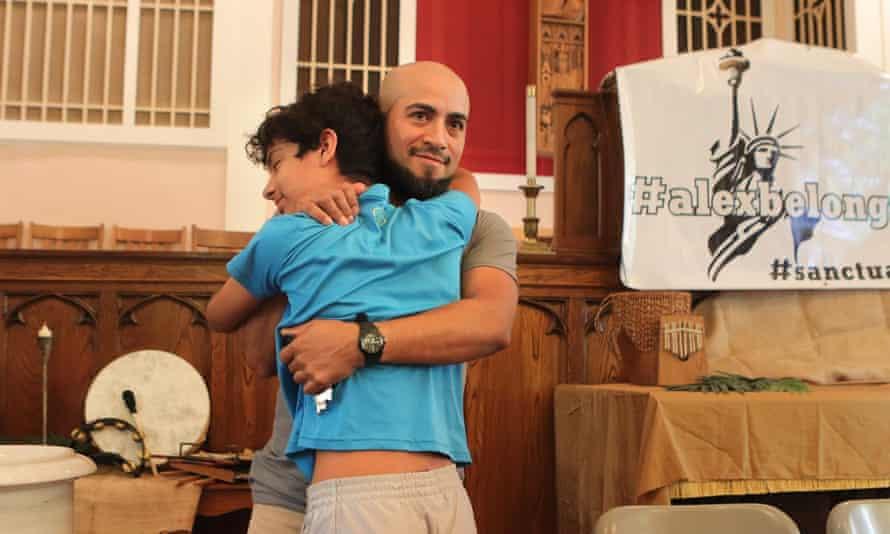 Alex García hugs his son, Caleb, 13, 0n 12 July 2019 at Christ Church United Church of Christ.